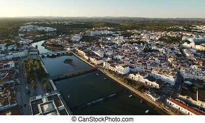 Aerial. The view of the old Tavira and the bridge from the...