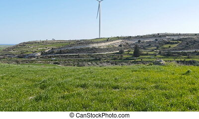 Windmills on the field. Eco power concept