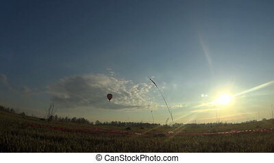 Hot air balloon over the field.