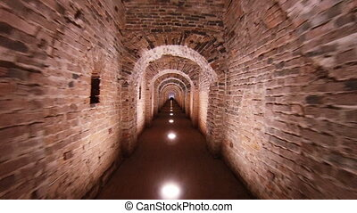 Corridor in the fort, brick walls and arches.