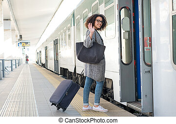 Young black woman waiting for the train