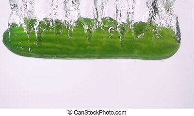 Ripe Cucumber Falling Through Water.