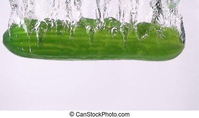 Ripe Cucumber Falling Through Water. Dark Background. Slow...