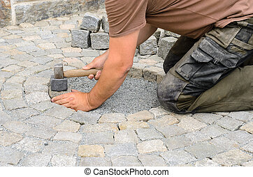 Installing stone blocks - Construction worker installing...