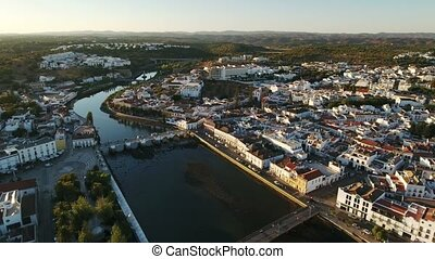 Aerial. Roman old bridge in Tavira, view from the sky. Ria...