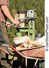 Log splitter - Man is using a electric log splitter