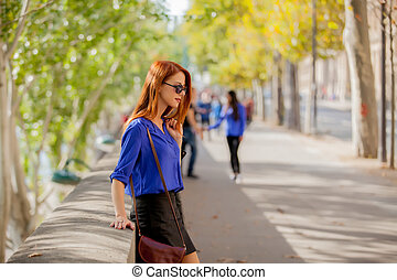 beautiful young woman walking in the park