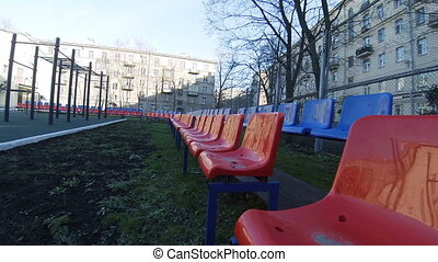 Seats for spectators on the playground.