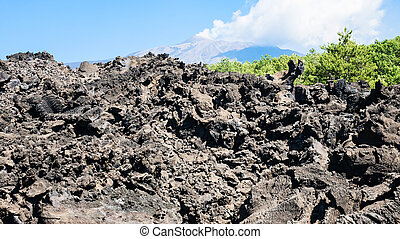petrified lava flow after volcano Etna eruption - travel to...
