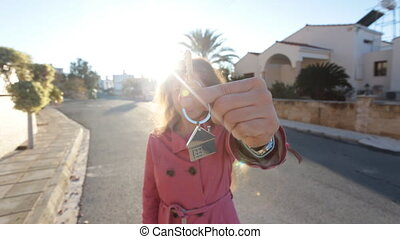 A woman with a key from a new house