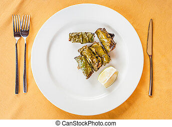 top view of sicilian meatballs in lemon leaves