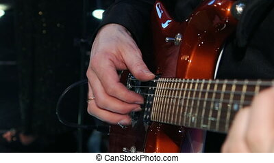 a man plays the guitar, hands