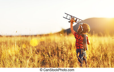 Child pilot aviator with airplane dreams of traveling in...