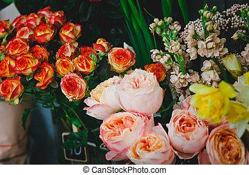 lots of flowers in a flower shop