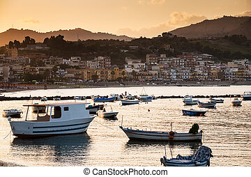 boats in marina of Giardini Naxos town on sunset