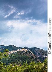 rain clouds over Castiglione di Sicilia town - travel to...