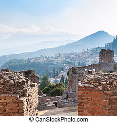 brick walls of ancient Teatro Greco in Taormina - travel to...