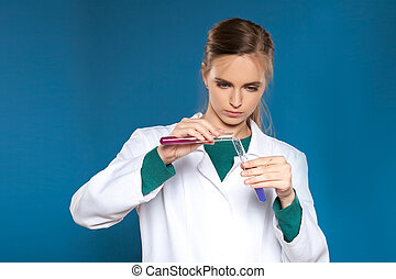 female chemist with a test tube on a blue background