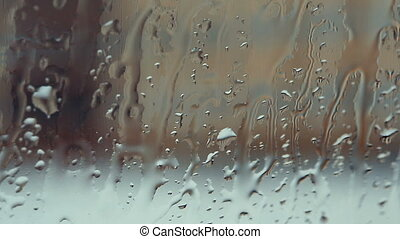 Drops of water flow down beautifully on the glass. V
