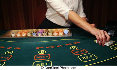 Casino: Dealer shuffles the poker cards