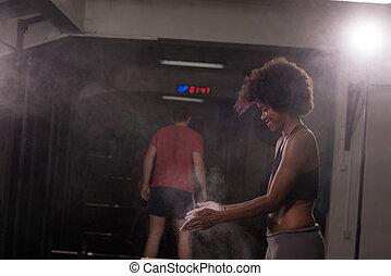 black woman preparing for climbing workout - Gym Chalk...