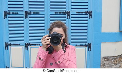 Woman photographer with camera on the street. - Woman with...