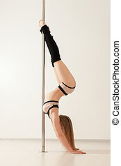 Sexy pole dance woman in lingerie upside down - Young sexy...