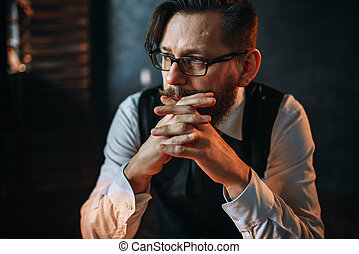Serious brooding bearded man in glasses - Portrait of...