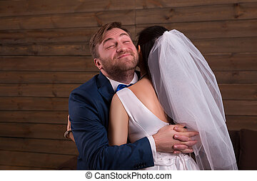 Happy newlyweds embracing after marriage proposal