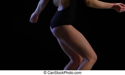 girl dances girl in black tight underwear. Medium frame plan...