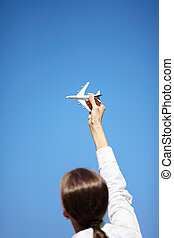 time for travel - natural light woman on blue sky...
