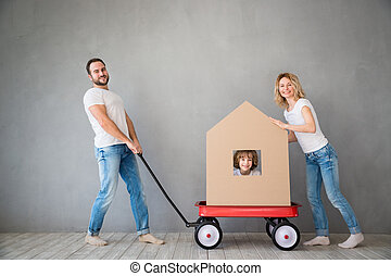Family New Home Moving Day House Concept - Happy family...