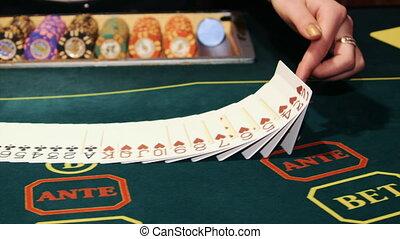 Casino: Dealer shuffles the poker cards