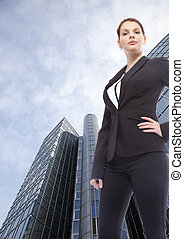 Young businesswoman standing in front of  office building