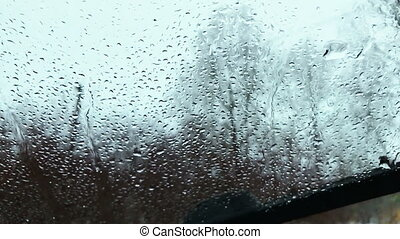Car wipers cleaned the windshield of water droplets. Slow...
