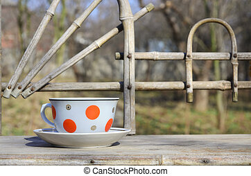 Rustic still life with a cup of tea on a wooden hand-made...