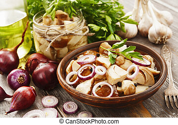 Boletus, pickled mushrooms - Pickled mushrooms in the...