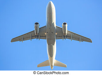 behind white airplane in the sky - low angle view of a white...