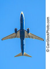 blue plane in the sky - blue passenger airplane flight...