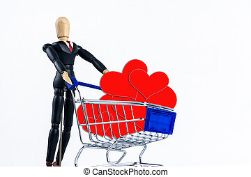 Shopping cart with red hearts paper on white background