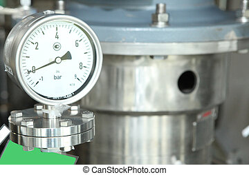 Gates, taps, monometers at the pharmaceutical plant. Open the supply of medicine to the reactor. Manometers in production. Adjustment of air supply and pressure.