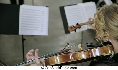 Close-up of musician playing violin.