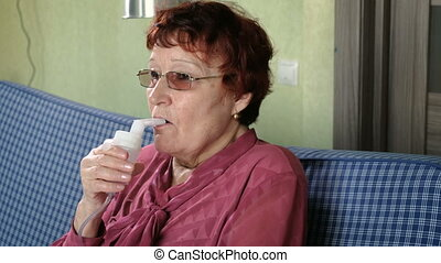 Grandmother makes inhalation at home