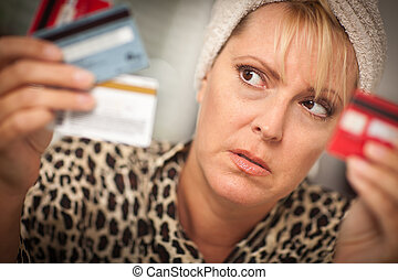 Upset Woman Glaring At Her Many Credit Cards - Upset Robed...