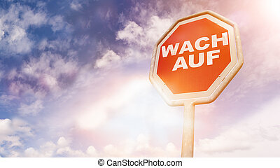 Wach auf, German text for Wake up text on red traffic sign -...