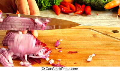 Slicing Red Onion In Slow Motion - Closeup of chef hands...