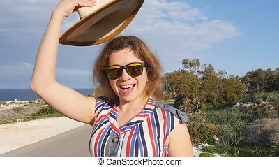 A woman in a hat and sunglasses on vacation