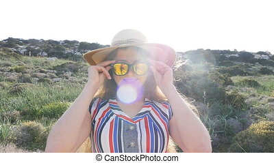 A woman in a hat and sunglasses on vacation - Young woman...