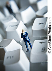 figurine placed with computer keys