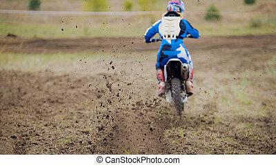 Motocross racer start riding his dirt Cross MX bike,...